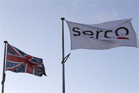 A Serco flag is seen flying alongside a Union flag outside Doncaster Prison in northern England in this December 13, 2011 file photograph. REUTERS/Darren Staples/Files