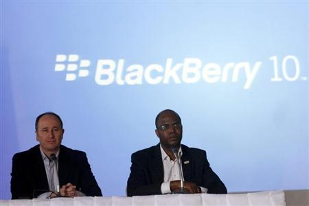 BlackBerry's Senior Director for Product Management Roger Enright (L) sits with Uzo Eziukwu, CEO of Parkway Projects which is partnering with BlackBerry, during the launch of the new BB Z10 smartphone in Nigeria's commercial capital Lagos March 7, 2013. REUTERS/Akintunde Akinleye