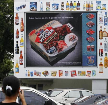 San Miguel corp different food products display at the video monitor outside a warehouse along the busy street of Manila August 9, 2007. REUTERS/Romeo Ranoco
