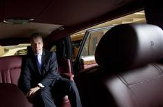 Torsten Mueller Oetvoes, chief executive officer of Rolls-Royce Motor Cars Ltd., poses for photos after an interview at a Rolls-Royce showroom in Hong Kong January 11, 2012. REUTERS/Tyrone Siu