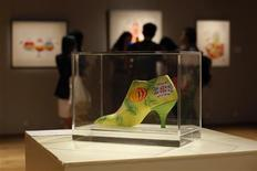 An art work by U.S. artist Andy Warhol is displayed at Sotheby's Hong Kong Gallery September 11, 2013. REUTERS/Bobby Yip