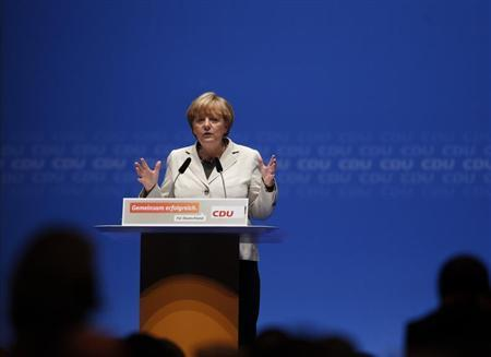 German Chancellor and Christian Democratic Union CDU leader Angela Merkel makes a speech during the election campaign rally in Duesseldorf September 8, 2013. REUTERS/Ina Fassbender