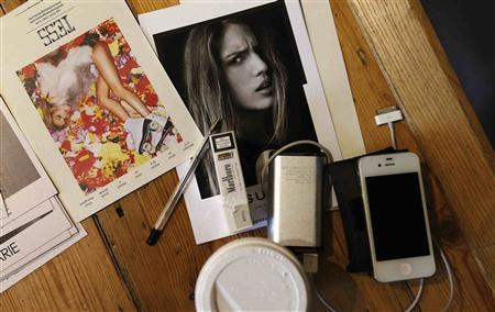 Photographs of models are seen on the floor during a casting call for Haizhen Wang's Spring/Summer 2014 collection in central London in this file photograph dated September 6, 2013. REUTERS/Suzanne Plunkett/files