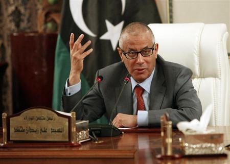 Libya's Prime Minister Ali Zeidan speaks during a joint news conference with Oil Minister Abdelbari al-Arusi at the Prime Minister's Office in Tripoli July 31, 2013. REUTERS/Ismail Zitouny