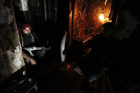 Free Syrian Army fighters smoke cigarettes as they rest in Aleppo's Qastal al-Harami neighbourhood September 11, 2013. REUTERS/Nour Kelze