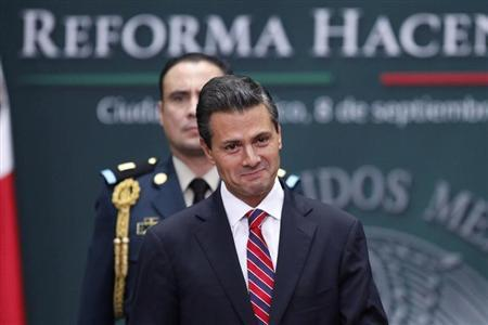 Mexico's President Enrique Pena Nieto smiles during the presentation of the fiscal reform at Los Pinos presidential residence in Mexico City, September 8, 2013. REUTERS/Edgard Garrido