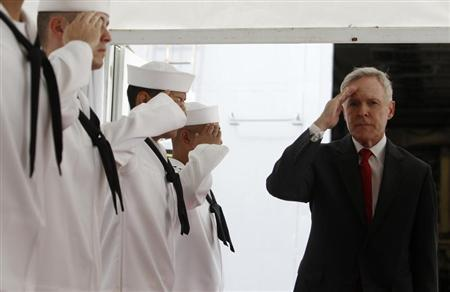 U.S. Secretary of the Navy Ray Mabus salutes servicemen onboard the USS Freedom littoral combat ship during a visit at Changi Naval Base in Singapore May 11, 2013. REUTERS/Edgar Su
