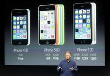 Phil Schiller, senior vice president of worldwide marketing for Apple Inc, talks about the pricing of their new products at Apple Inc's media event in Cupertino, California September 10, 2013. REUTERS/Stephen Lam