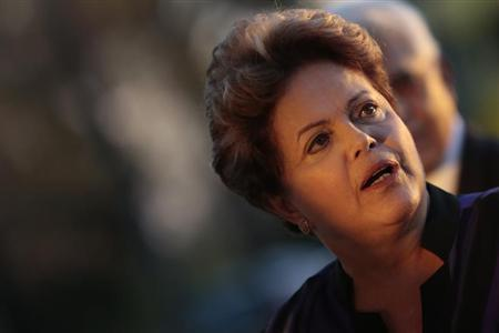 Brazil's President Dilma Rousseff reacts during a reception for the Brazilian Football delegation at the Alvorada Palace in Brasilia September 2, 2013. REUTERS/Ueslei Marcelino