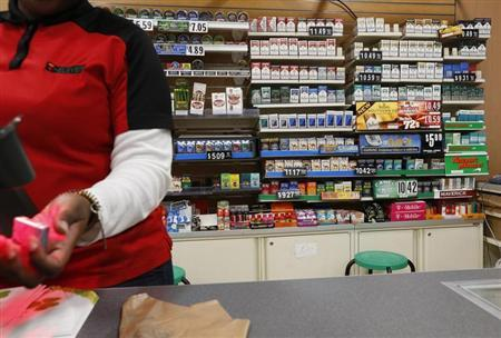 Cigarettes are displayed behind the counter of a convenient store in New York, March 18, 2013. REUTERS/Brendan McDermid