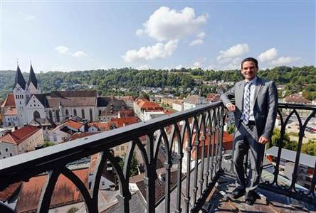 Andreas Steppberger, mayor of Eichstaett, poses on the city's townhall tower August 29, 2013. REUTERS-Michael Dalder