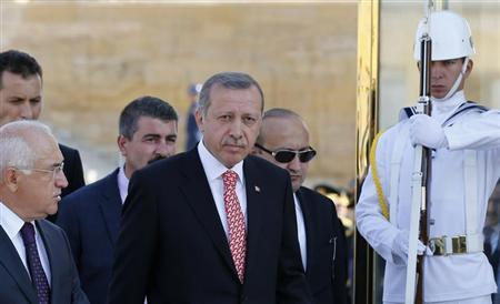 Turkish Prime Minister Tayyip Erdogan (C) attends a ceremony marking the 91st anniversary of Victory Day at the mausoleum of Mustafa Kemal Ataturk, founder of modern Turkey, in Ankara August 30, 2013. REUTERS/Umit Bektas