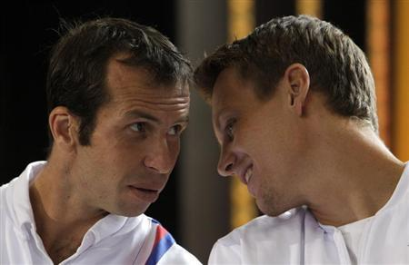 Czech Republic's Radek Stepanek (L) and Tomas Berdych chat during the draw for the Davis Cup semifinals in Prague September 12, 2013. REUTERS/David W Cerny