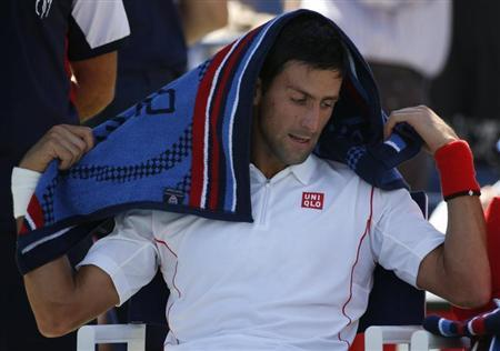 Novak Djokovic of Serbia pauses during a break in play against Stanislas Wawrinka of Switzerland during their men's semi-final match at the U.S. Open tennis championships in New York September 7, 2013. REUTERS/Adam Hunger
