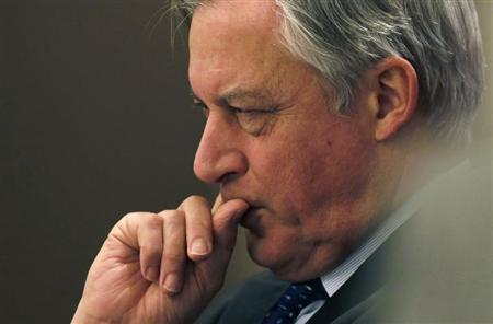 European Central Bank (ECB) governing council member Christian Noyer listens to a speech by Bank of Japan Governor Masaaki Shirakawa (not seen) at the Paris Europlace Financial Forum in Tokyo December 3, 2012. REUTERS/Yuriko Nakao