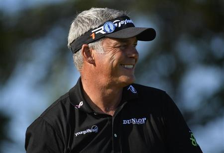 Darren Clarke of Northern Ireland smiles as he stands on the second tee during the second round of the British Open golf Championship at Muirfield in Scotland July 19, 2013. REUTERS/Toby Melville