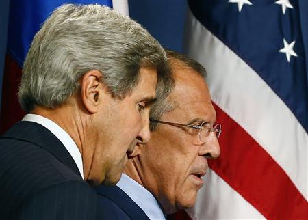 Russia's Foreign Minister Sergey Lavrov (R) and U.S. Secretary of State John Kerry arrive for a news conference at a hotel in Geneva September 12, 2013. REUTERS/Ruben Sprich