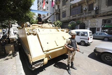 A soldier stands next to an armoured personnel carrier (APC) near the al-Fath mosque on Ramses Square in Cairo, September 11, 2013. REUTERS/Mohamed Abd El Ghany