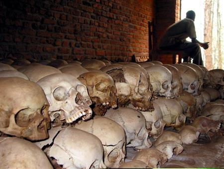 Rwandan genocide survivor Pacific Rutaganda, 48, is seen in this February 2004 file picture looking out of the door of a church full with human skulls and bones in the town of Ntarama where he survived an ethnic massacre that killed several hundred people during the central African country's 1994 genocide.