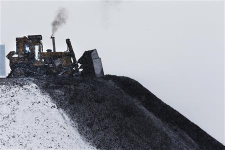 A bulldozer spreads processed coal at the Century Mine near Beallsville, Ohio, January 25, 2013. REUTERS/Jason Cohn