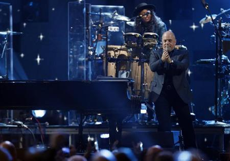 Billy Joel performs during the ''12-12-12'' benefit concert for victims of Superstorm Sandy at Madison Square Garden in New York December 12, 2012. REUTERS/Lucas Jackson