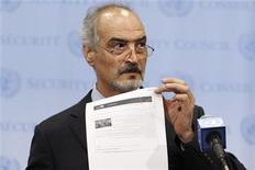 Syrian U.N. Ambassador Bashar Ja'afari shows a document to reporters at the United Nations Headquarters in New York, September 12, 2013. REUTERS/Brendan McDermid