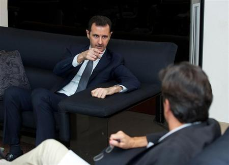 Syria's president Bashar al-Assad gestures during an interview with French daily Le Figaro in Damascus in this handout distributed by Syria's national news agency SANA on September 2, 2013. REUTERS/SANA/Handout
