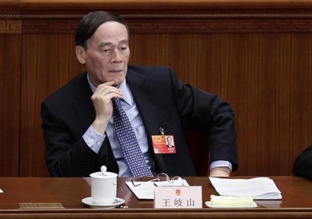 China's Vice Premier Wang Qishan attends a plenary meeting of the National People's Congress (NPC), China's parliament, at the Great Hall of the People in Beijing, March 8, 2012. REUTERS/Jason Lee