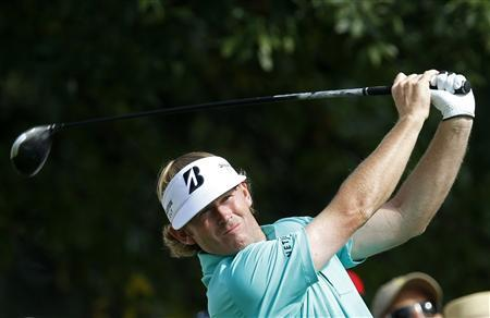 Brandt Snedeker of the U.S. reacts after finishing the first round of the BMW Championship golf tournament at the Conway Farms Golf Club in Lake Forest, Illinoi, September 12, 2013. REUTERS/Jim Young