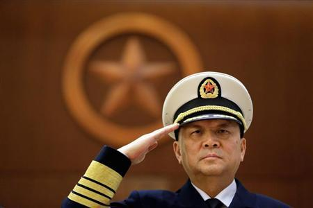 Commander of the Chinese People's Liberation Army (PLA) Navy Wu Shengli salutes during a welcoming ceremony for United States Secretary of the Navy Ray Mabus at the PLA Navy Headquarters, in Beijing November 27, 2012. REUTERS/Jason Lee/Files