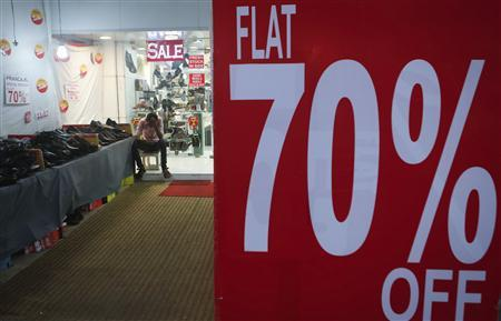 A salesman waits for customers inside a footwear store at a market in Mumbai in this September 11, 2013 file photo. REUTERS/Danish Siddiqui/Files