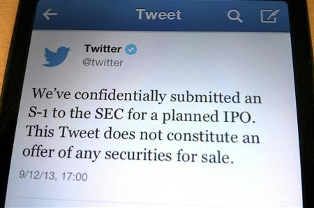 A tweet from Twitter Inc. announcing its initial public offering is shown in this photo illustration in Toronto, September 12, 2013. REUTERS-Hyungwon Kang