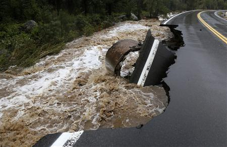 A section of Highway 72 is missing after a flash flood tore through Coal Creek near Golden, Colorado September 12, 2013. REUTERS-Rick Wilking