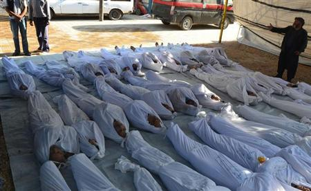 ATTENTION EDITORS - VISUALS COVERAGE OF SCENES OF DEATH AND INJURY Syrian activists inspect the bodies of people they say were killed by nerve gas in the Ghouta region, in the Duma neighbourhood of Damascus August 21, 2013. REUTERS/Bassam Khabieh