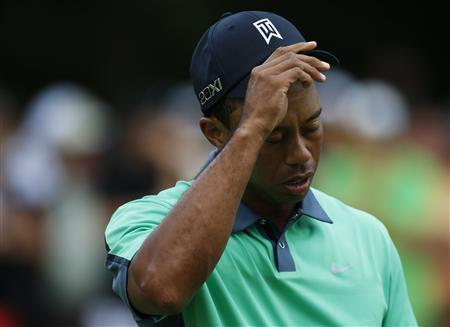 Tiger Woods of the U.S. walks off the course after finishing the first round of the BMW Championship golf tournament at the Conway Farms Golf Club in Lake Forest, Illinois, September 12, 2013. REUTERS/Jim Young