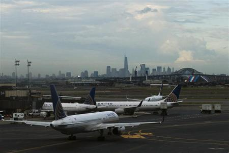 United Airlines' planes are seen at the Newark Liberty International Airport in New Jersey, July 2, 2013. REUTERS/Eduardo Munoz