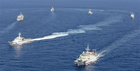 Vessels from the China Maritime Surveillance and the Japan Coast Guard are seen near disputed islands, called Senkaku in Japan and Diaoyu in China, in the East China Sea, in this photo taken by Kyodo September 10, 2013.REUTERS/Kyodo
