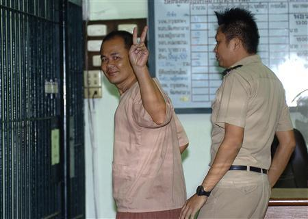 Yuthapoom Martnok, 36, gestures as he arrives at the criminal court in Bangkok September 13, 2013. REUTERS/Stringer