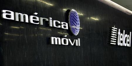 The logos of America Movil and its commercial brand Telcel are seen on the wall of the reception area in the company's new corporate offices in Mexico City February 8, 2011. REUTERS/Henry Romero