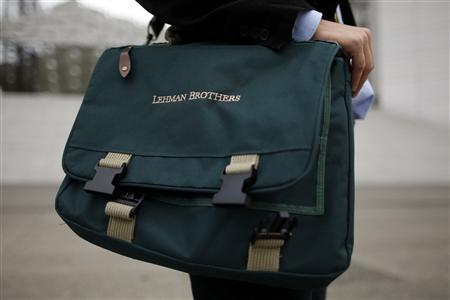 Edouard d'Archimbaud poses with his Lehman Brothers' bag before an interview with Reuters in La Defense September 11, 2009. REUTERS/Benoit Tessier