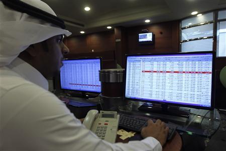 A broker monitors stock prices on a screen at the Saudi Investment Bank in Riyadh September 5, 2013. REUTERS/Faisal Al Nasser