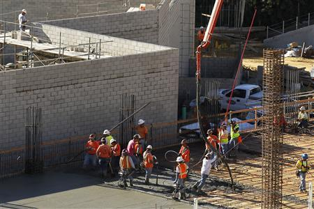 Construction workers are seen on the job building a shopping center complex in Solana Beach, California January 6, 2012. REUTERS/Mike Blake