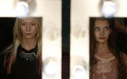 Models are reflected in mirrors backstage at the Felder Felder Spring/Summer 2014 collection during London Fashion Week September 13, 2013. REUTERS/Olivia Harris