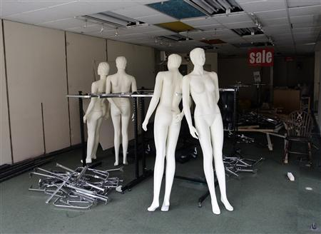 Mannequins stand in a closed clothes shop in Derby, central England, in this September 8, 2009 file picture. REUTERS/Darren Staples/Files