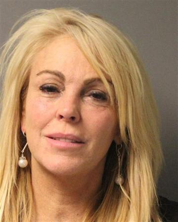 Dina Lohan is pictured in this undated booking photo courtesy of the New York State Police. Lohan, the mother of troubled actress Lindsay Lohan, was arrested and charged with drunken driving on the night of September 12, 2013, after she was stopped for speeding in New York, police said on Friday. REUTERS/New York State Police/Handout