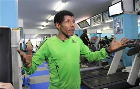 Ethiopian marathon runner Haile Gebrselassie speaks during a Reuters interview in his gymnasium in Ethiopia's capital Addis Ababa, July 16, 2013. REUTERS/Tiksa Negeri