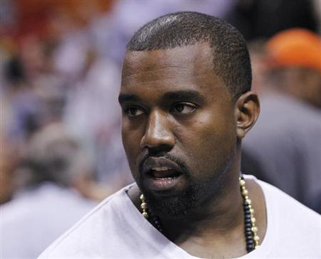 Rap musician Kanye West is seen court side as the Miami Heat play the New York Knicks in their NBA basketball game in Miami, Florida in this December 6, 2012 file photo. REUTERS/Andrew Innerarity