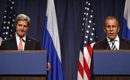 U.S. Secretary of State John Kerry (L) pauses while Russian Foreign Minister Sergei Lavrov answers a question, following meetings regarding Syria, at a news conference in Geneva September 14, 2013. REUTERS/Larry Downing