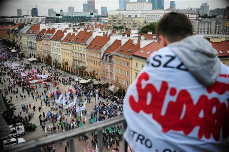 A protester from the Solidarity trade union looks down as people gather for an anti-government protest in central Warsaw September 14, 2013. REUTERS/Adam Stepien/Agencja Gazeta