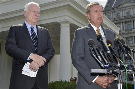 U.S. Senator Lindsey Graham (R-SC), (R), makes remarks to the media as U.S. Senator John McCain (R-AZ), (L), listens, after meeting with U.S. President Barack Obama at the White House, on possible military action against Syria, in Washington September 2, 2013. REUTERS/Mike Theiler